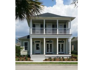 Charleston style two story home. Front porch with second story balcony.